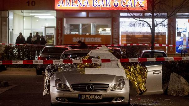 A car in front of one the two bars attacked in Hanau, Germany Thursday, Feb. 20, 2020. (AP Photo/Michael Probst)