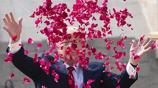 President Donald Trump throws rose petals during a ceremony at the Raj Ghat Mahatma Gandhi Memorial, in New Delhi, India.