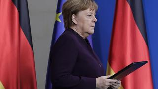 German Chancellor Angela Merkel arrives for a statement at the chancellery in Berlin, Germany, Thursday, Feb. 20, 2020.