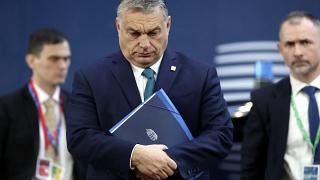 Hungarian Prime Minister Viktor Orban, center, arrives for an EU summit at the European Council building in Brussels, Friday, Feb. 21, 2020.