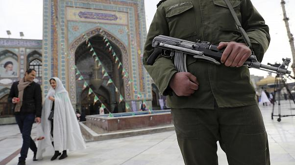 A soldier guards at a polling station during the parliamentary elections in Tehran, Iran, Friday, Feb. 21, 2020.