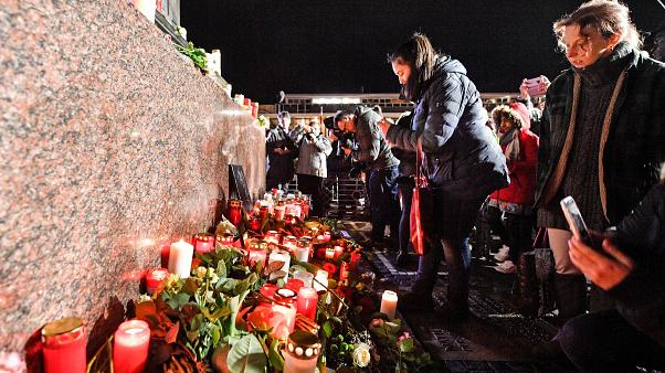 Mourners at a vigil for the victims of a shooting in Hanau