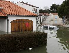 Flooded streets of La Faute sur Mer, on the Atlantic coast, south western France are seen after a storm, Monday, March 1, 2010. _AP_David Vincent