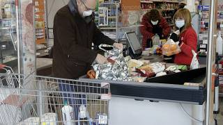 Residents queue for supplies at supermarket after COVID-19 coronavirus outbreak