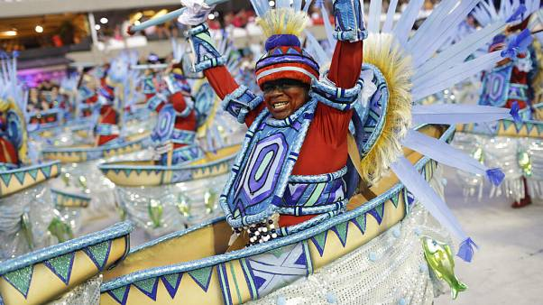 Performers from the Portela samba school parade during Carnival celebrations at the Sambadrome in Rio de Janeiro, Brazil.