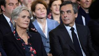 François Fillon with his wife Penelope at an election campaign rally in Paris, January 2017.
