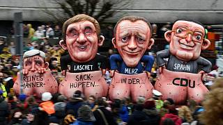 """""""Sack race for men only in the CDU"""": a carnival float depicting the leadership race, seen during the Rose Monday carnival street parade in Dusseldorf, February 24, 2020."""