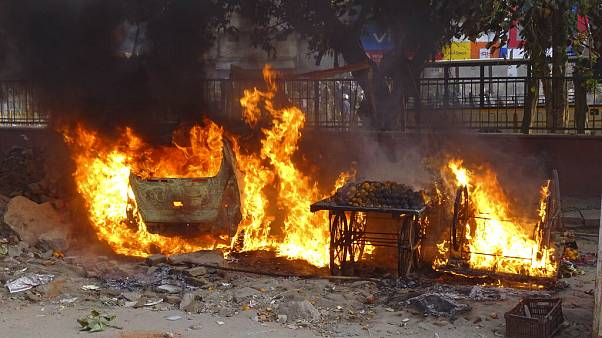 Carts belonging to street vendors go up in flames after clashes in New Delhi