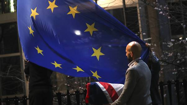 The UK flag is removed from the European Parliament in Brussels, January 31, 2020, the day the UK left the EU. (AP Photo/Francisco Seco)
