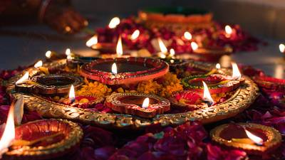 Flowers and candles during Diwali.