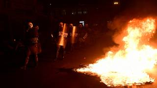 Protesters clashed with police over the building of new migrant camps on the island of Lesbos