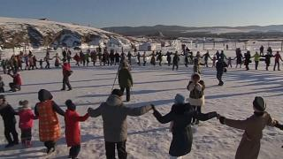 On a frozen Siberian lake, festival-goers mark the Lunar New Year