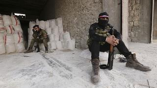 Turkish backed Syrian fighters prepare to go to a frontline near the village of Neirab, in Idlib province, Syria, Monday, Feb. 24, 2020. (AP Photo/Ghaith Alsayed)