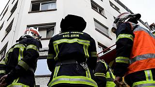 Firefighters at the scene of the Strasbourg fire that prosecutors believe could have been deliberate