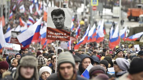 Demonstrators march in memory of opposition leader Boris Nemtsov in Moscow, Russia, Sunday, Feb. 24, 2019.