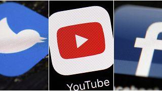 شعار موقع يوتيوب يتوسط شعاري فيسبوك وتويتر.