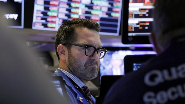 Trader Leon Montana works on the floor of the New York Stock Exchange, Friday, Feb. 28, 2020.