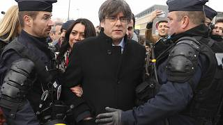 olice surround Catalonia's former regional president Carles Puigdemont as he arrives at the European Parliament in Strasbourg, eastern France, Monday, Jan. 13, 2020.