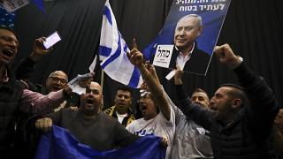 Supporters of Israeli Prime Minister Benjamin Netanyahu celebrate after first exit poll results for Israeli elections in Tel Aviv, Israel, Monday, March 2, 2020.