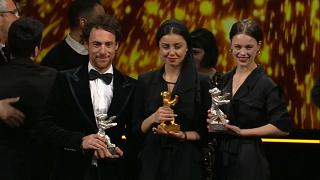 """Elio Germano and Paula Beer with their Silver Bears, surrounding Alireza Zareparast, actress from """"There Is No Evil"""", Golden Bear"""