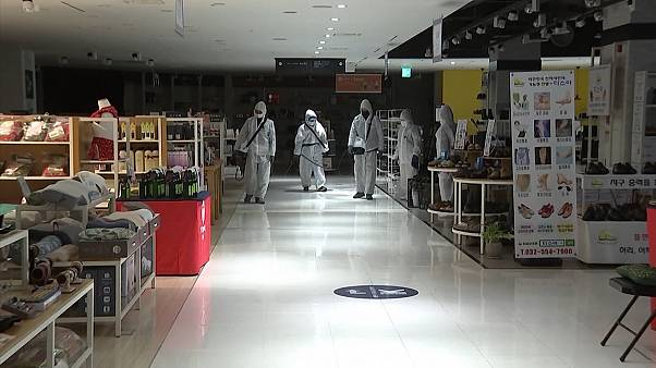 Workers disinfect South Korea department store as COVID-19 spreads