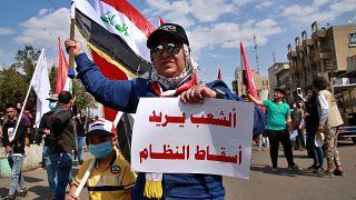 """متظاهرو العراق لا يخشون كورونا ويعتبرون أن السياسيين هم """"الفيروس الحقيقي"""""""