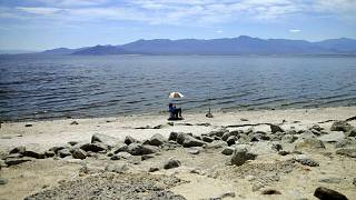 A man fishes along the receding banks of the Salton Sea near Bombay Beach, California, USA; in April 30; 2015.