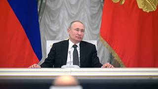 Russian President Vladimir Putin attends a meeting with members of a working group created to discuss constitutional amendments in the Kremlin in Moscow.