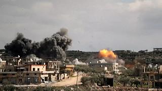 Smoke billows after air strikes hit Syrian towns of Al-Bara and Baylun