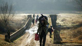 Migrants walk to enter Greece from Turkey by crossing the Maritsa river near the Pazarkule border gate in Edirne, Turkey.