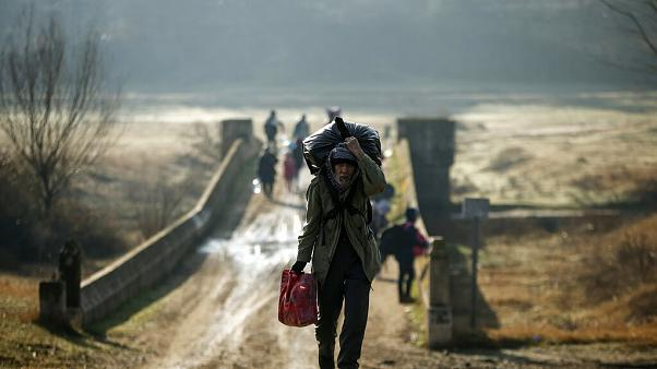 Migrants walk to enter Greece from Turkey by crossing the Maritsa river near the Pazarkule border gate in Edirne, Turkey.