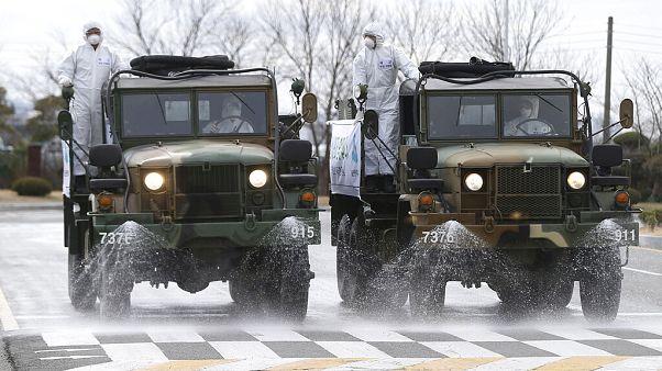 Army trucks spray disinfectant against coronavirus on a street Ulsan, South Korea