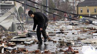 A man walks through storm debris following a deadly tornado in Nashville, Tennessee, USA.