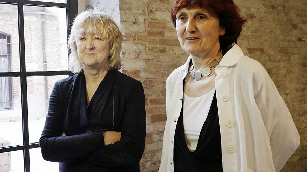 In this May 23, 2018 file photo, Biennale International Architecture exhibition curators Yvonne Farrell, left, and Shelley McNamara appear in Venice, Italy.