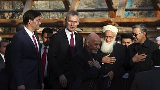 Afghan President Ashraf Ghani, center, arrives with NATO Secretary General Jens Stoltenberg, and U.S. Secretary of Defense Mark Esper for a joint news conference, Feb 29, 2020