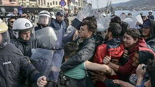 Migrants scuffle with Greek police at the port of Mytilene after locals block access to the Moria refugee camp, on the northeastern Aegean island of Lesbos, Greece.