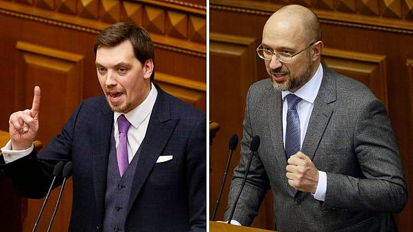 Left, former prime minister Oleksiy Honcharuk. Right, Ukraine's new prime minister Denys Shmygal at the parliament session hall in Kyiv, Ukraine, Wednesday, March 4, 2020.