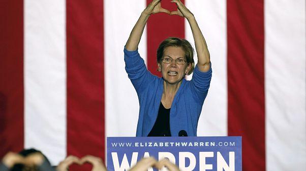 Massachusetts Senator Elizabeth Warren makes the shape of a heart