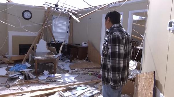 Tornado survivors clung to furniture to avoid being carried away
