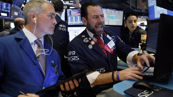Traders work on the floor of the New York Stock Exchange, March 3, 2020.