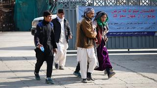 Gunmen attack a political gathering in Kabul, killing at least 27 people, injuring dozens