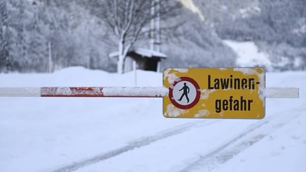 "A sign saying ""danger of avalanches"" in Weissbach near Lofer, Austrian province of Salzburg, Jan. 11, 2019.(AP Photo/Kerstin Joensson)"