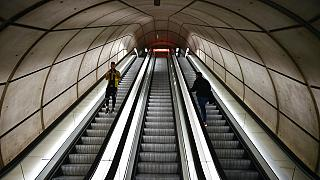 Passengers use the escalators of an empty subway station, in Bilbao, northern Spain,