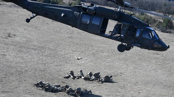 Soldiers of an American unit are dropped by a UH-60 Black Hawk helicopter at a military training center nearby Ujdoeroegd, Hungary, on March 5, 2020.