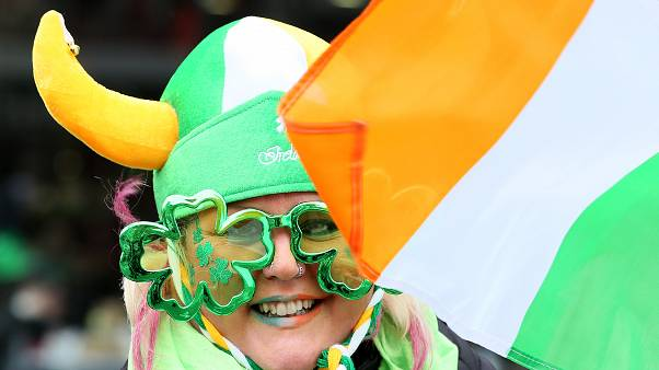 Participants gather for the annual St Patricks Day parade through the city centre of Dublin on March 17, 2019. (Photo by Paul FAITH / AFP)