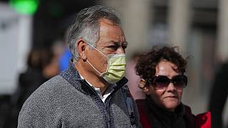 People wearing masks in Spain to prevent the spread of coronavirus COVID-19.