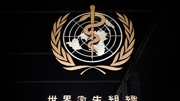 A picture taken on March 9, 2020 shows the sign of the World Health Organization