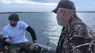 Os pescadores que patrulham a fronteira grega