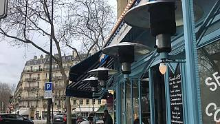Gas heaters keep a terrace warm near Paris' Luxembourg gardens.