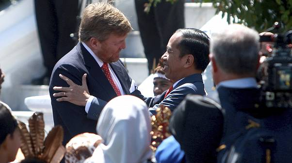 King Willem-Alexander of the Netherlands is welcomed by Indonesian President Joko Widodo on his arrival at the presidential palace in Bogor.
